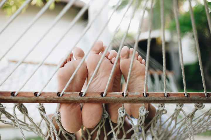 photo of bare feet on hammock
